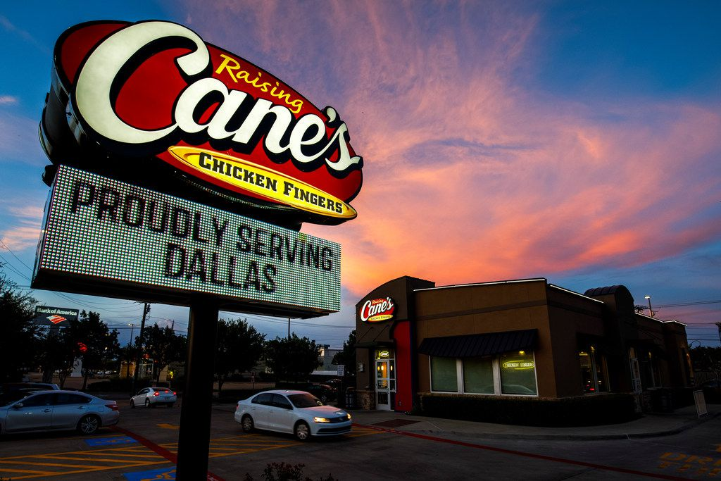 "A message proclaims Raising Cane's service to Dallas on the sign for location #76 in the 5000 block of Greenville Ave, nicknamed ""The Pony Express"" due to proximity to SMU, on Friday, July 28, 2017, in Dallas. (Smiley N. Pool/The Dallas Morning News)"