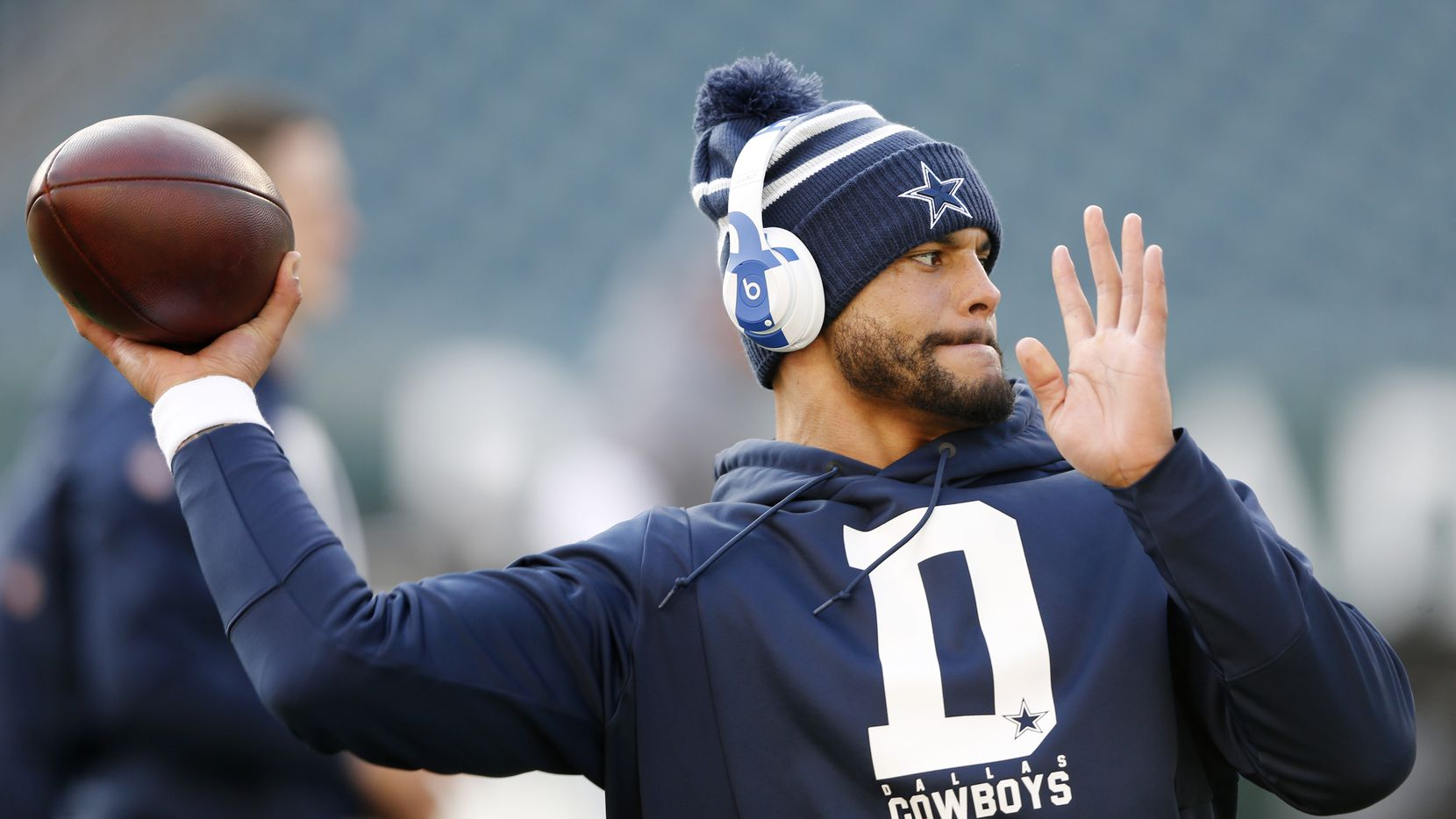 Dallas Cowboys quarterback Dak Prescott (4) throws the ball before warmups prior to a game against the Philadelphia Eagles at Lincoln Financial Field in Philadelphia on Sunday, December 22, 2019.