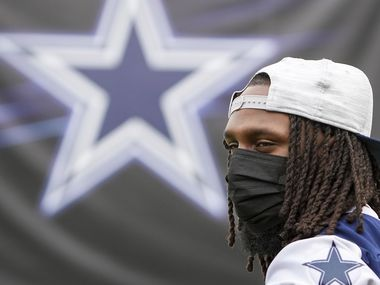 Newly signed Dallas Cowboys safety Malik Hooker watches from the sidelines during a practice at training camp on Tuesday, July 27, 2021, in Oxnard, Calif.