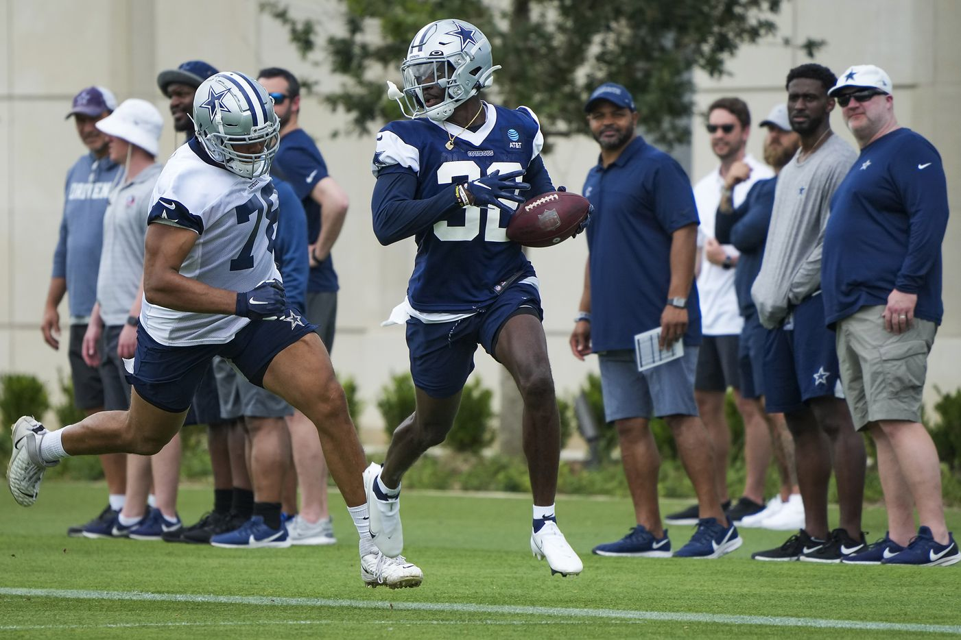 Dallas Cowboys safety Jayron Kearse (32) races past tackle Terence Steele (78) with a turnover during a minicamp practice at The Star on Wednesday, June 9, 2021, in Frisco. (Smiley N. Pool/The Dallas Morning News)