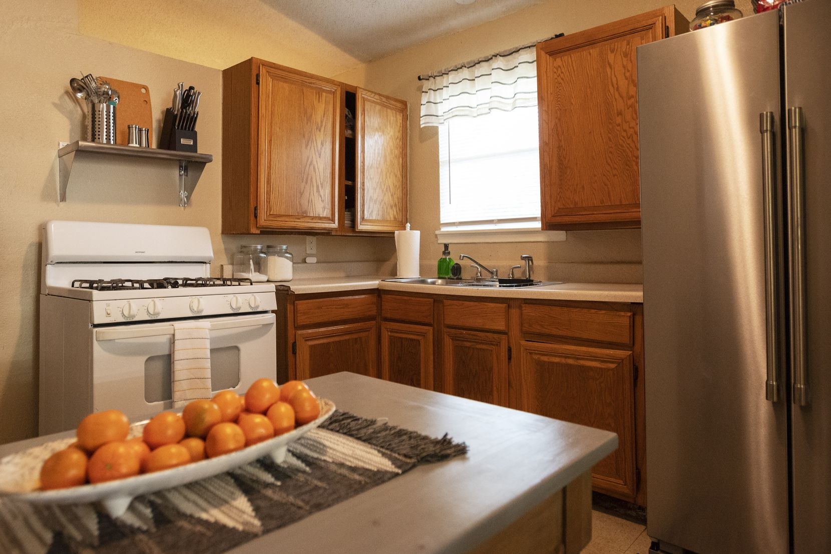 Kimberly Bobb's newly decorated kitchen includes a full-size refrigerator, which replaces the too-small fridge her family had been relying on.