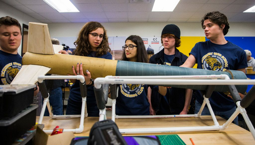 The McKinney High School Flying Lions Rocketry Club explains their nearly ten foot long rocket on Tuesday, March 14, 2017 at McKinney High School in McKinney, Texas. The team has been awarded an eight-month unfunded NASA contract to design and build a reusable high-powered rocket and payload that they will launch to an altitude of one mile above ground level. In April, they will join 17 other high school teams at NASA's Marshall Space Flight Center in Huntsville, Alabama. (Ashley Landis/The Dallas Morning News)