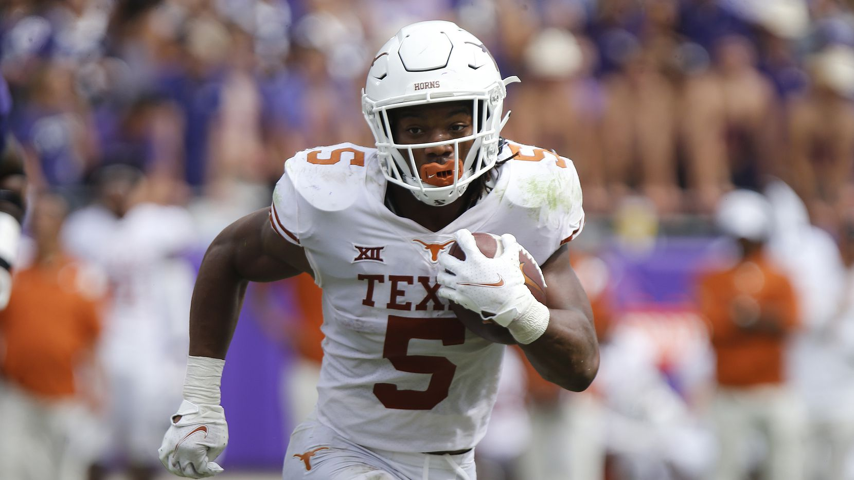 Texas Longhorns running back Bijan Robinson (5) carries the ball for a first down during the second half as the TCU Horned Frogs hosted the Texas Longhorns on Saturday, October 2, 2021, at Amon G Carter Stadium in Fort Worth.