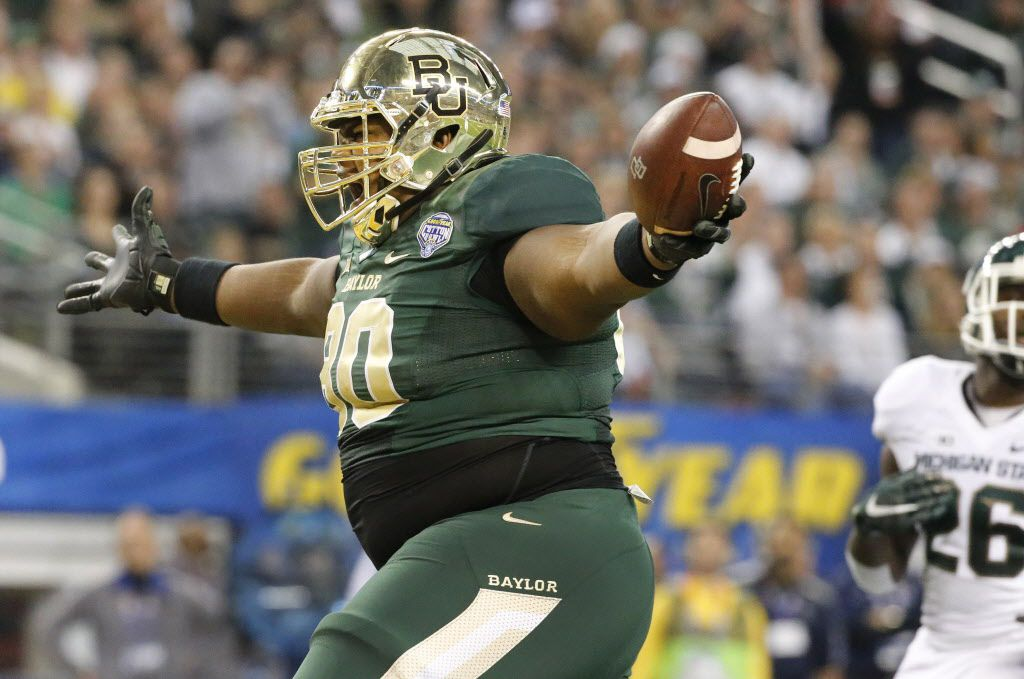 Offensive lineman LaQuan McGowan (80) exults as he crosses the goal line after catching a third quarter touchdown pass during the 2015 Goodyear Cotton Bowl between the Baylor University Bears and the Michigan State University Spartans at AT&T Stadium