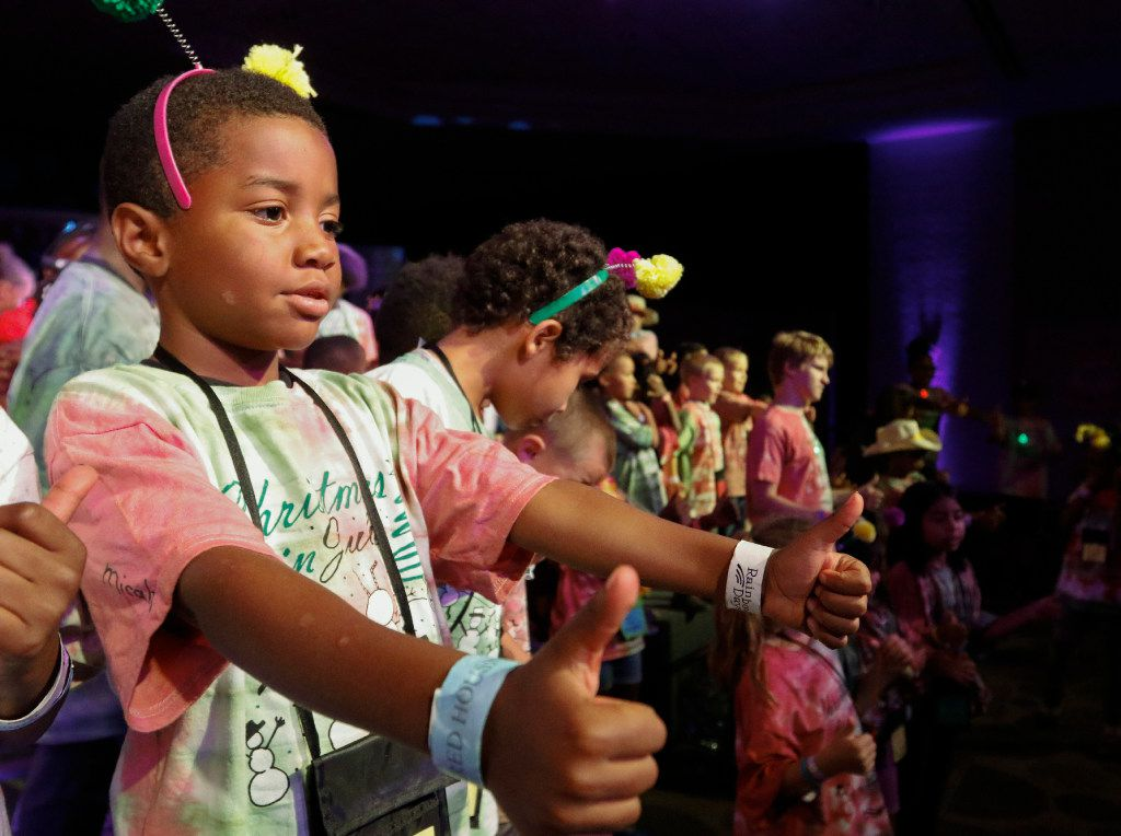 Micah Wilson,7, performs in the show's finale with fellow campers at Camp Bravo.