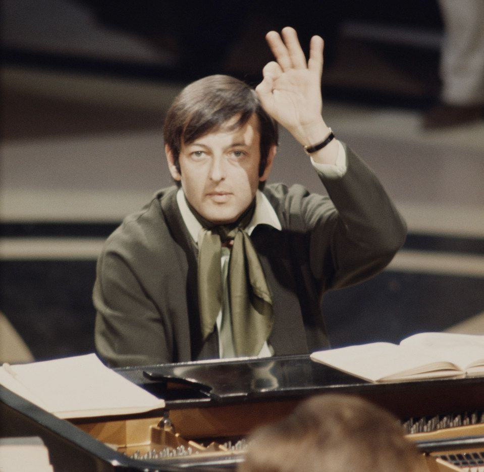 American pianist, conductor and composer Andre Previn at the piano, circa 1965. Previn, former L.A. Philharmonic music director and four-time Oscar winner, has died at age 89.