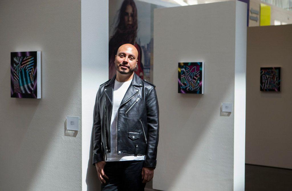 Artist Arthur Peña  alongside his artwork at NorthPark Center