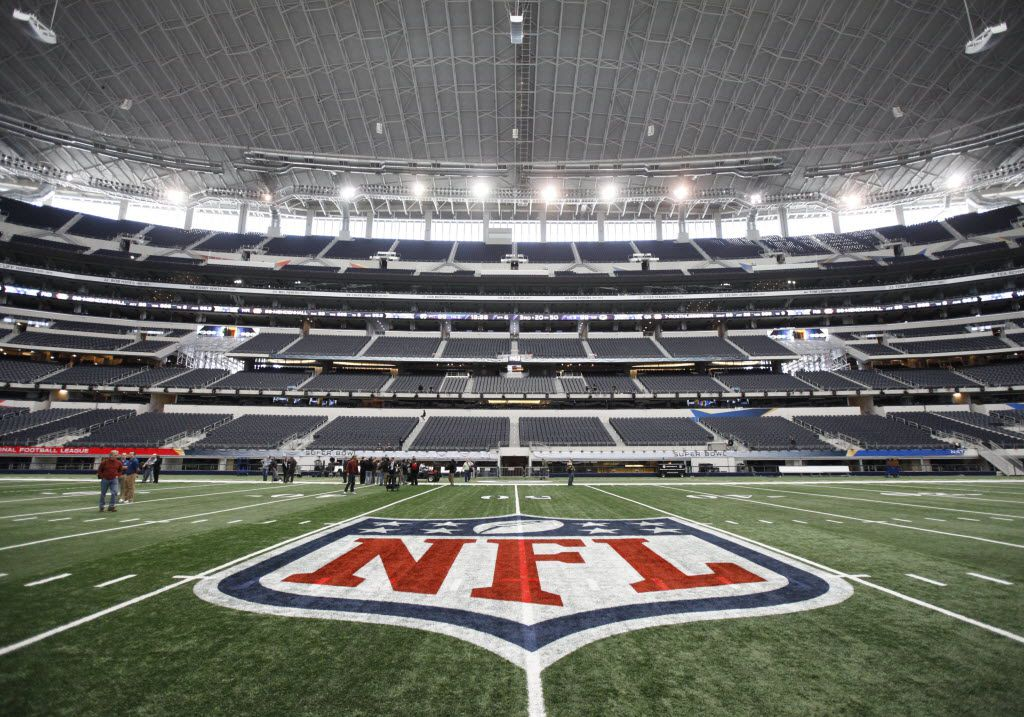 FILE - The NFL logo, painted at midfield, is pictured above at AT&T Stadium in Arlington on Jan. 27, 2011.