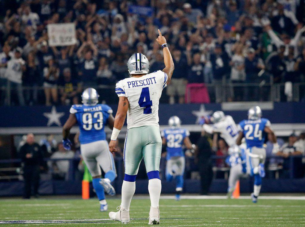 Dallas Cowboys quarterback Dak Prescott (4) raises his hand as running back Ezekiel Elliott (21) scores a touchdown against Detroit Lions during the first quarter at AT&T Stadium in Arlington, Texas, Monday, Dec. 26, 2016. (Jae S. Lee/The Dallas Morning News)