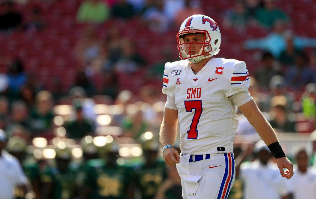 TAMPA, FLORIDA - SEPTEMBER 28: Shane Buechele #7 of the Southern Methodist Mustangs celebrates a touchdown during a game against the South Florida Bulls at Raymond James Stadium on September 28, 2019 in Tampa, Florida.