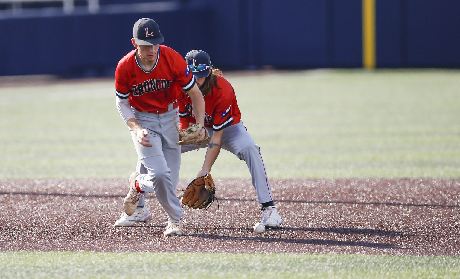 Mansfield Legacy's Parker Ibrahimi (1) and Raef Wright (9) misplay a RBI single hit by Birdville's Hogan Shelby (11) during the second inning of a high school Class 5A Region I quarterfinal series baseball game at Dallas Baptist University, Thursday, May 20, 2021. (Brandon Wade/Special Contributor)