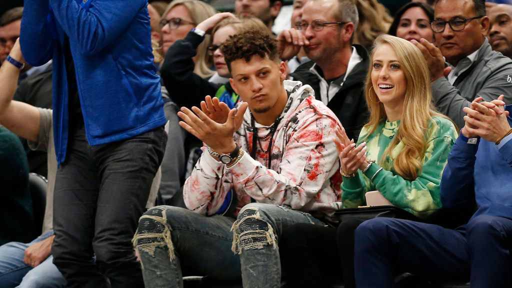 Kansas City Chiefs quarterback Patrick Mahomes sits court side during the first quarter of play between the Dallas Mavericks and New Orleans Pelicans at American Airlines Center in Dallas on Wednesday, March 4, 2020.
