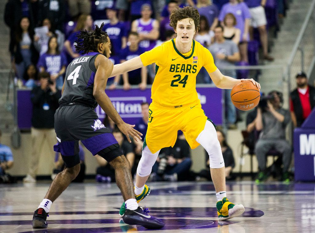 Baylor Bears guard Matthew Mayer (24) gets past TCU Horned Frogs guard PJ Fuller (4) during the first half of an NCAA mens basketball game between Baylor and TCU on Saturday, February 29, 2020 at Ed & Rae Schollmaier Arena on the TCU campus in Fort Worth. (Ashley Landis/The Dallas Morning News)