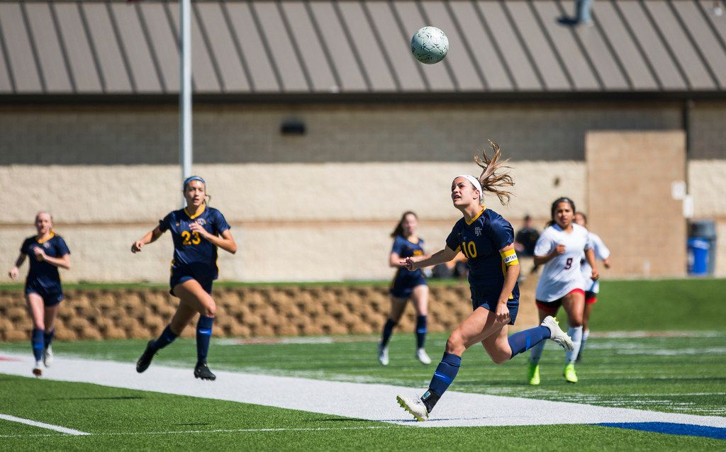 Highland Park forward Presley Echols (10) chases the ball after she headbutted it during the UIL conference 5A girls state final soccer game between Mansfield Legacy and Highland Park at Birkelbach Field in Georgetown, Texas on Saturday, April 20, 2019. The score was tied 0 to 0 at the end of the first half.