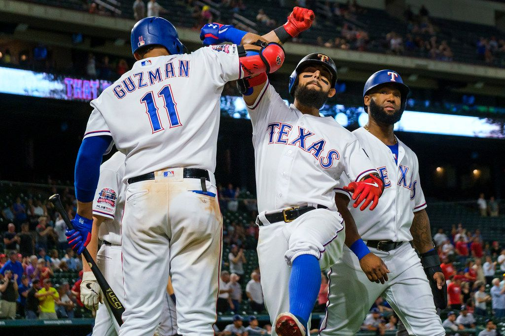 Texas Rangers second baseman Rougned Odor celebrates with first baseman Ronald Guzman after hitting a 3-run home run during the seventh inning against the Tampa Bay Rays at Globe Life Park on Wednesday, Sept. 11, 2019, in Arlington. (Smiley N. Pool/The Dallas Morning News)