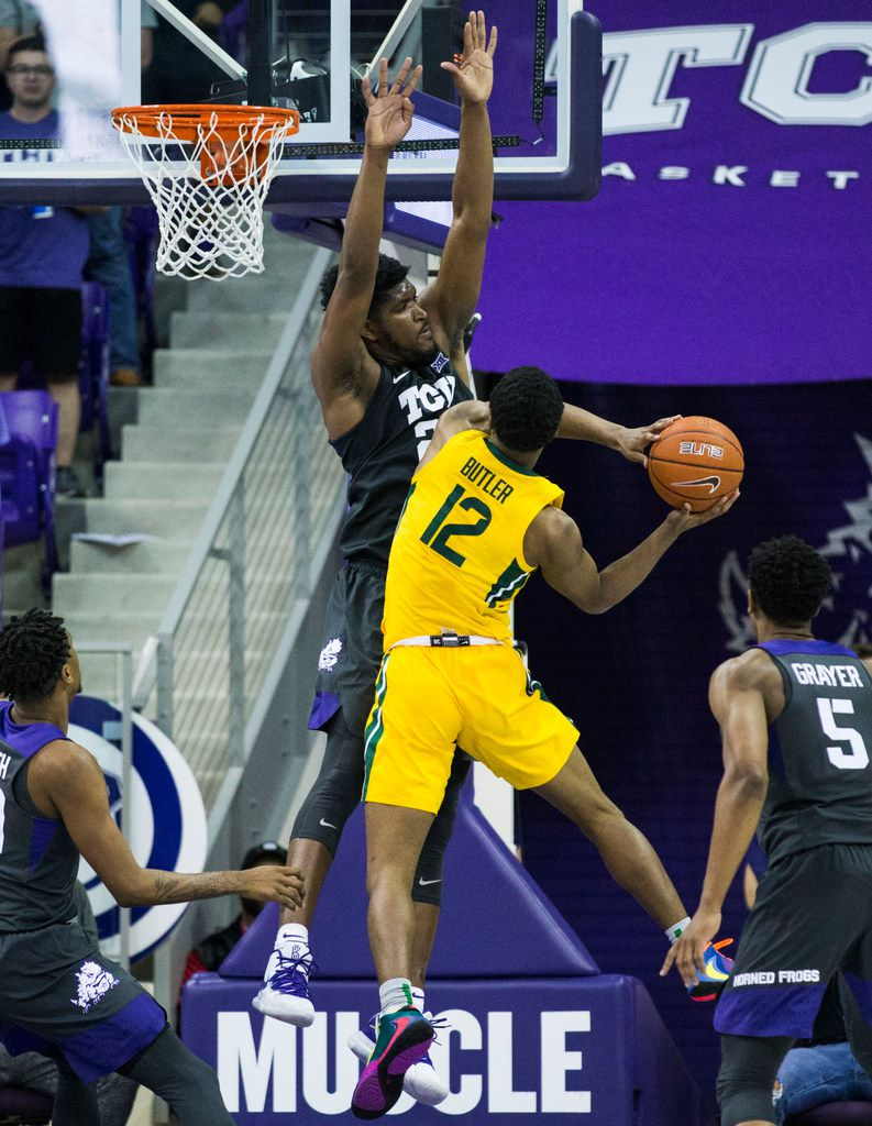 TCU Horned Frogs center Kevin Samuel (21) tries to block a shot by Baylor Bears guard Jared Butler (12) during the second half of an NCAA mens basketball game between Baylor and TCU on Saturday, February 29, 2020 at Ed & Rae Schollmaier Arena on the TCU campus in Fort Worth. (Ashley Landis/The Dallas Morning News)