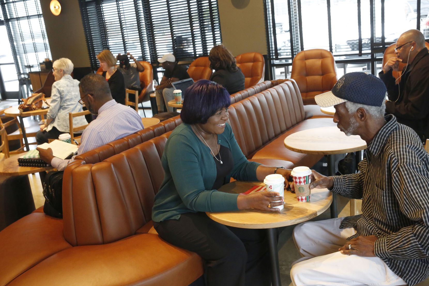 C.C. Ward and her husband, Harry Ward, of Duncanville, Texas, drink coffee at the newly opened Starbucks in the parking lot of Southwest Center Mall in Dallas Nov. 30, 2018. The renovated shopping center is now called Red Bird Mall.