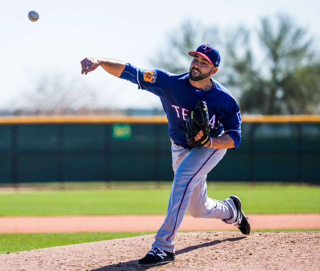 Texas Rangers starting pitcher Dillon Gee (36) pitches during a spring training workout at the team's training facility on Thursday, February 23, 2017 in Surprise, Arizona. (Ashley Landis/The Dallas Morning News)