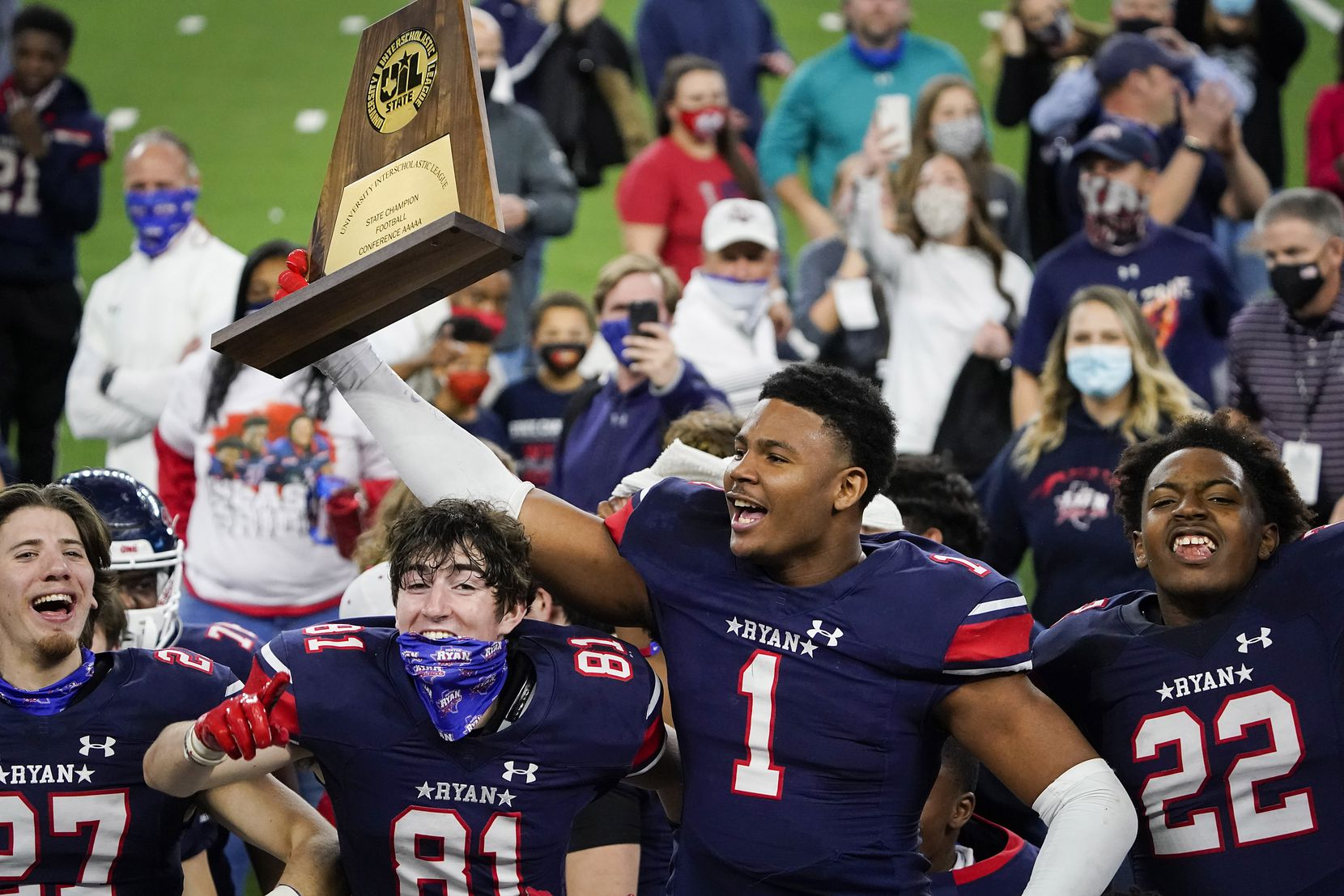 Denton Ryan wide receiver Ja'Tavion Sanders (1) lifts the championship trophy as the Raiders celebrate a 59-14 victory over Cedar Park to win the Class 5A Division I state football championship game at AT&T Stadium on Friday, Jan. 15, 2021, in Arlington, Texas. (Smiley N. Pool/The Dallas Morning News)