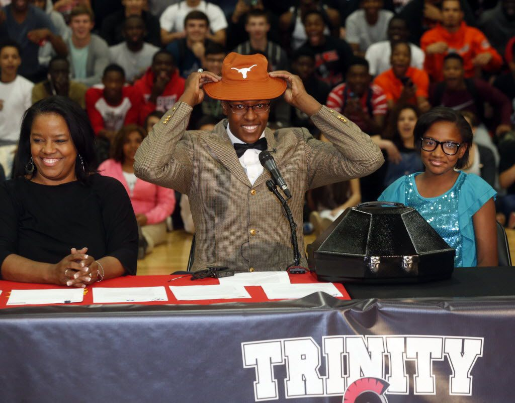 Euless Trinity basketball player Myles Turner, center, with mother Mary Turner, left, and sister, Mya Turner, 11,  announced his commitment to play for the University of Texas during a ceremony at Euless Trinity in  Euless, Texas, on April 30, 2014. (Michael Ainsworth/The Dallas Morning News)