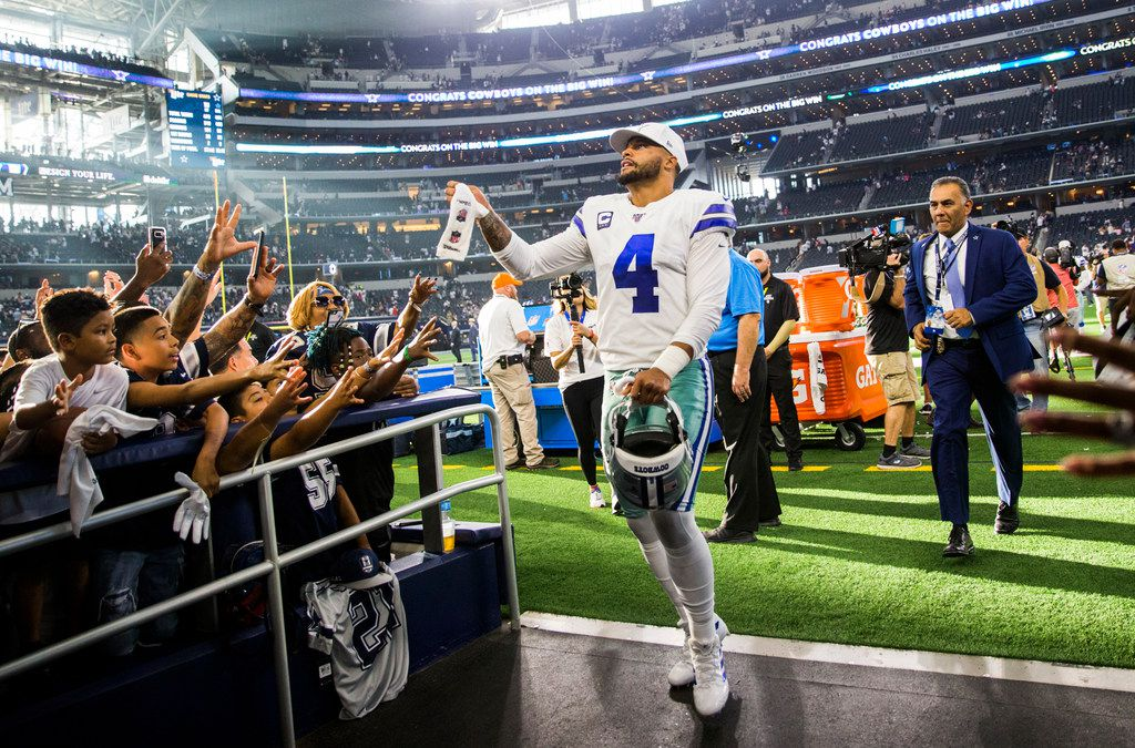 Dallas Cowboys quarterback Dak Prescott (4) leaves the field after a 35-17 win over the New York Giants on Sunday, September 8, 2019 at AT&T Stadium in Arlington.