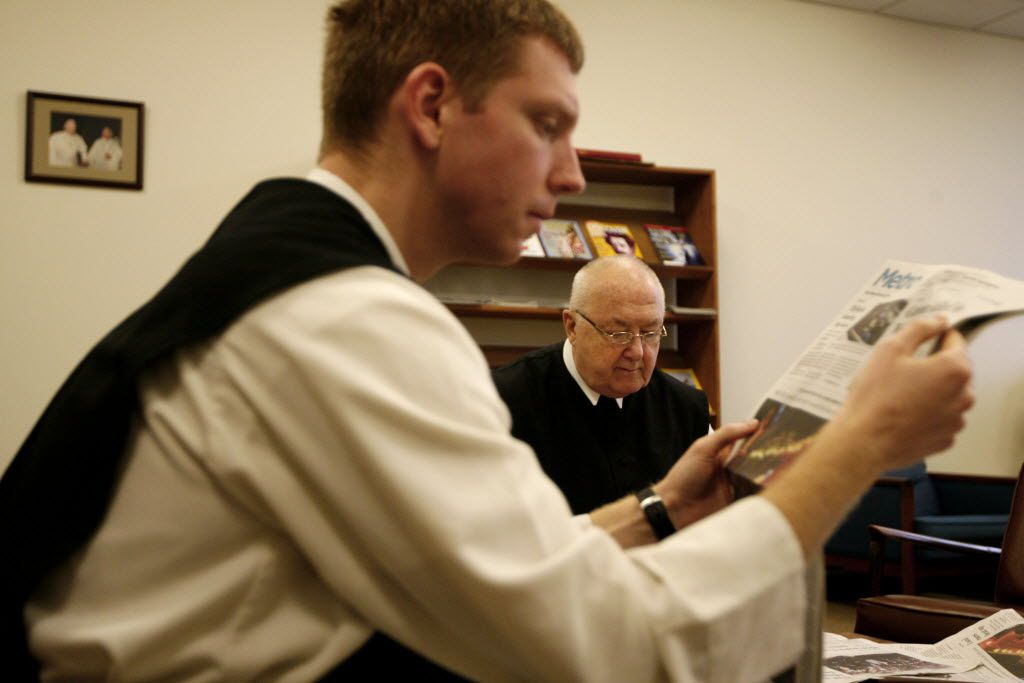 Brother Lawrence Brophy reads the newspaper with the Rev. Denis Farkasfalvy after the morning's conventual mass at 6:35 a.m. at Cistercian Abbey Our Lady of Dallas on March 8, 2010.