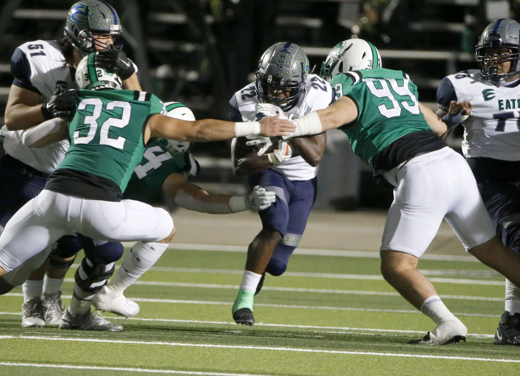 Southlake defenders Benecio Porras (32) and Andrew Askew (99) prepare to tackle Eaton running back Jahbez Hawkins (22) during their high school football game on Nov. 20, 2020.