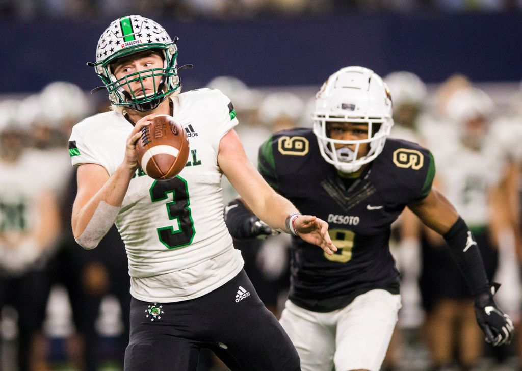 Southlake Carroll quarterback Quinn Ewers (3) escapes a sack attempt by DeSoto linebacker er Ridarius Branch (9) during the second quarter of a Class 6A Division I area-round high school football playoff game between Southlake Carroll and DeSoto on Friday, November 22, 2019 at AT&T Stadium in Arlington. (Ashley Landis/The Dallas Morning News)