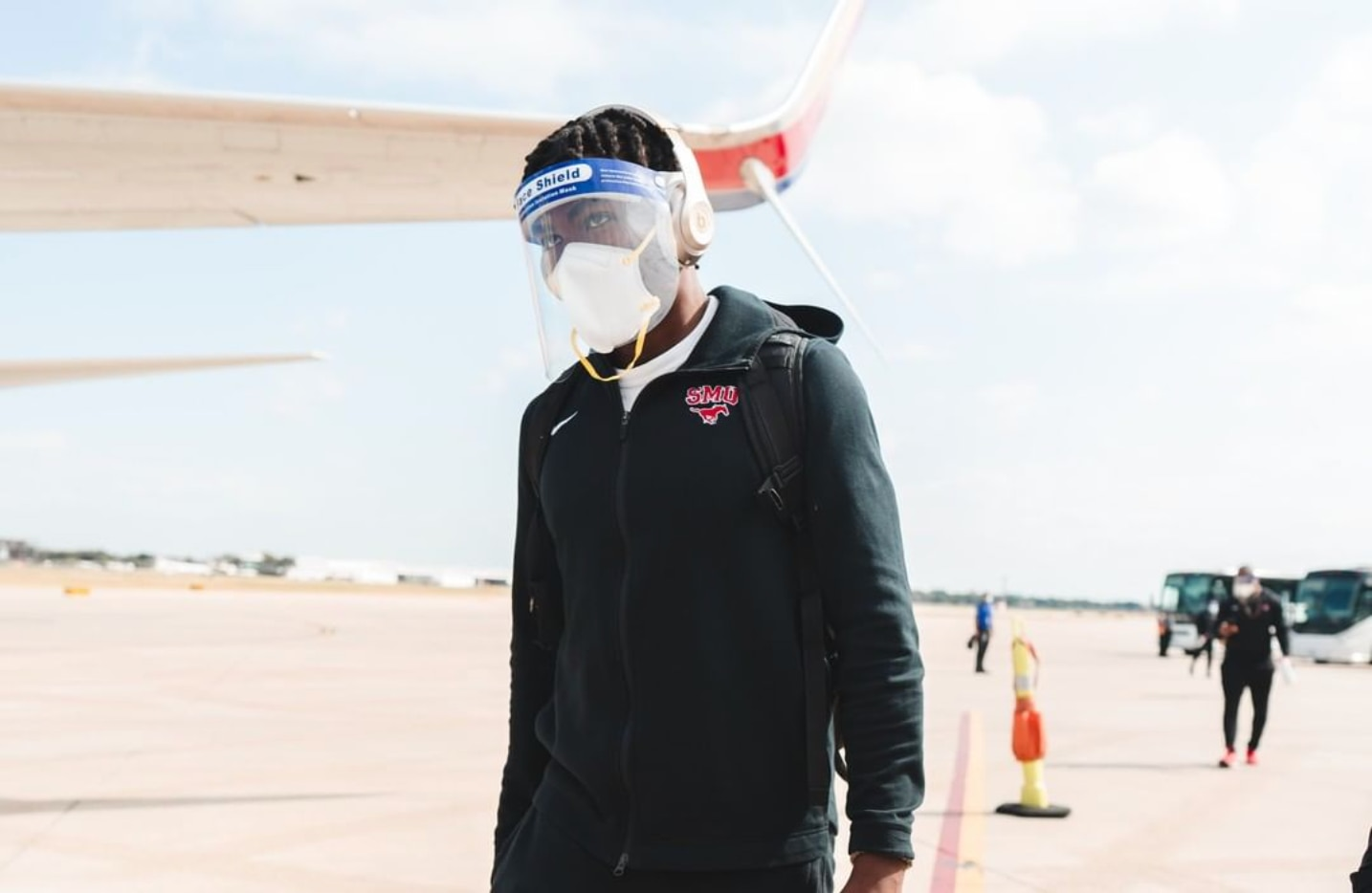 SMU wide receiver Rashee Rice exits the team plane after landing at Temple. (Courtesy of SMU Athletics).