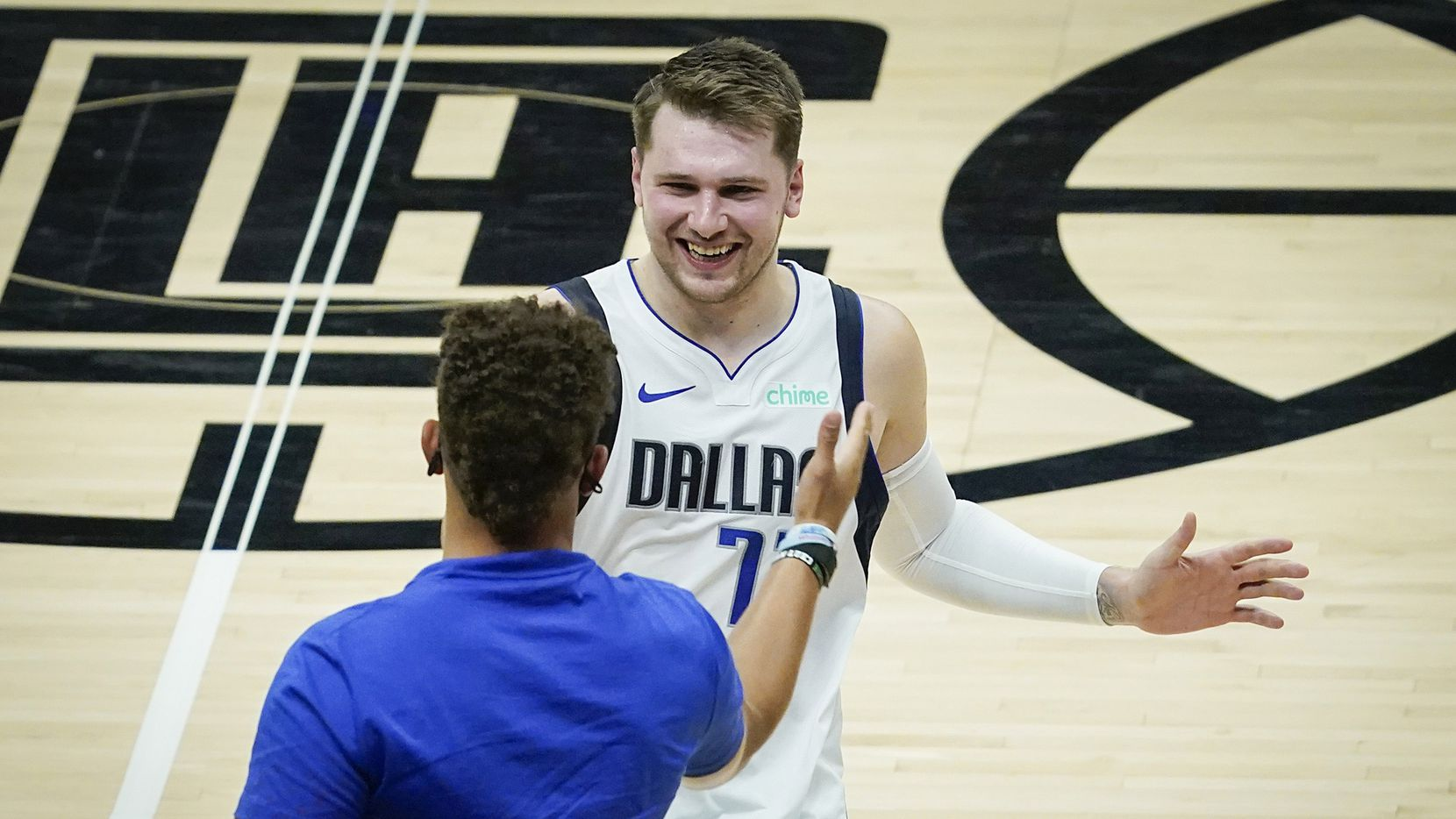 Dallas Mavericks guard Luka Doncic celebrates with Kansas City Chiefs quarterback Patrick Mahomes after the Mavericks 127-121 victory over the LA Clippers in an NBA playoff basketball game at Staples Center on Wednesday, May 26, 2021, in Los Angeles.