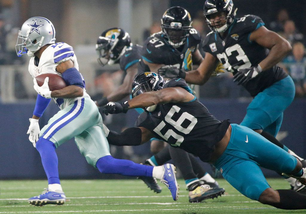 Dallas Cowboys wide receiver Tavon Austin (10) avoids four Jacksonville defendsers on a third quarter run during the Jacksonville Jaguars vs. the Dallas Cowboys NFL football game at AT&T Stadium in Arlington, Texas on Sunday, October 14, 2018. (Louis DeLuca/The Dallas Morning News)