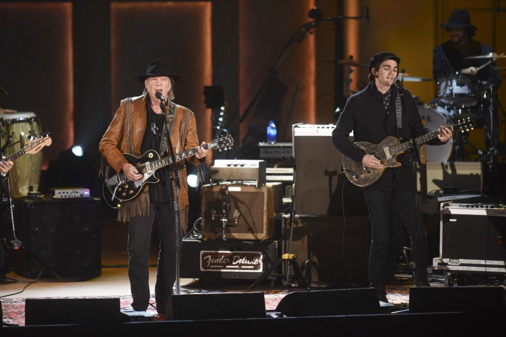 Neil Young sings during a show honoring Willie Nelson with the 2015 Library of Congress Gershwin Prize for Popular Song on Wednesday, Nov. 18, 2015 in Washington.