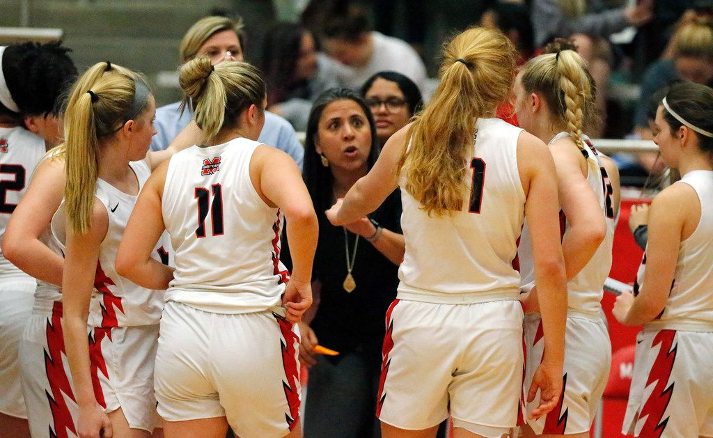 Flower Mound Marcus High School head coach Monica Pena talks to her team during a time out in the first half as Flower Mound Marcus High School hosted Irving MacArthur High School in a girls basketball game in Flower Mound on Tuesday, January 14, 2020. (Stewart F. House/Special Contributor)