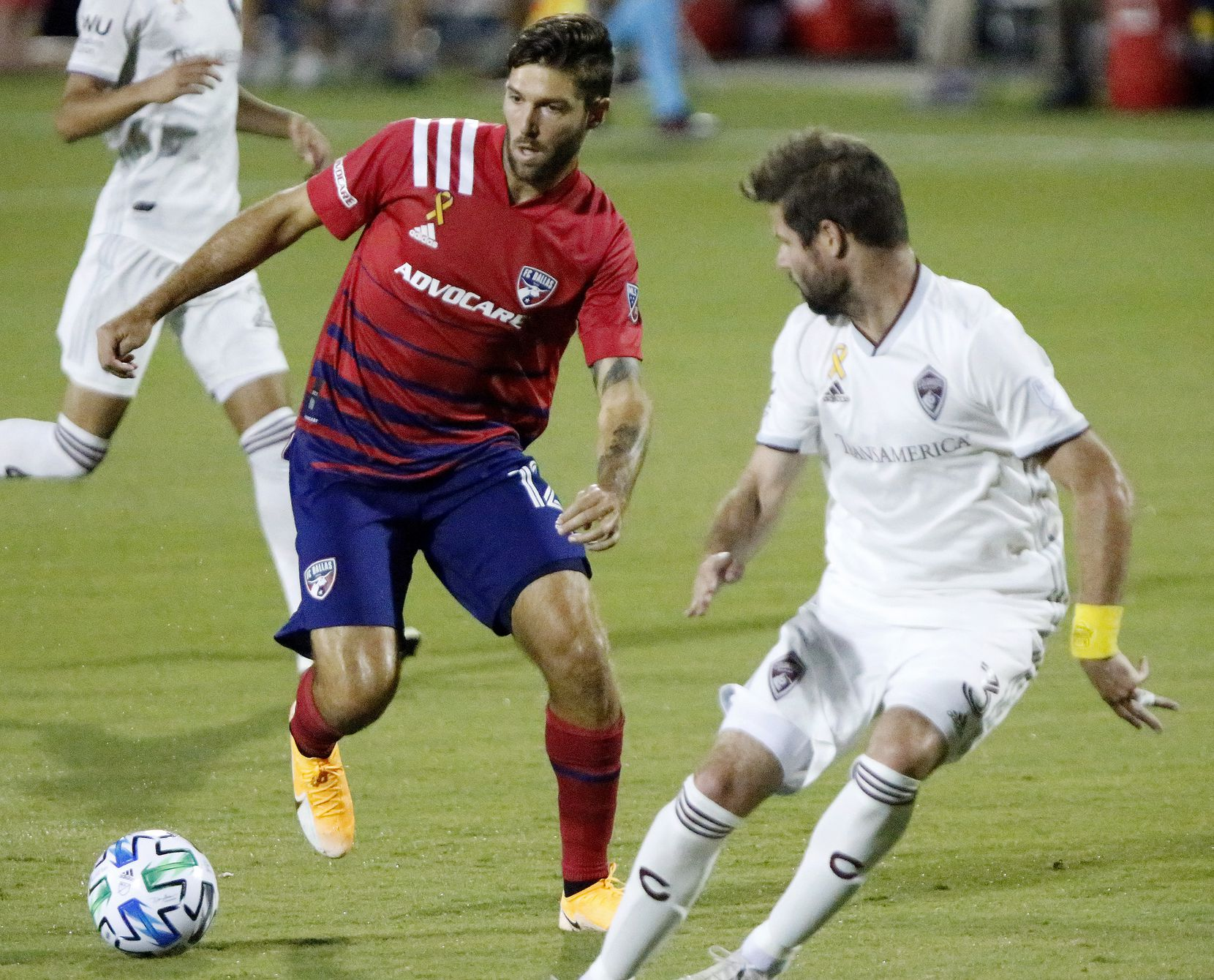 FC Dallas midfielder Ryan Hollingshead (12) dribbles past Colorado Rapids defender Drew Moor (3) during the first half as FC Dallas hosted the Colorado Rapids at Toyota Stadium in Frisco on Wednesday night, September 16, 2020. (Stewart F. House/Special Contributor)
