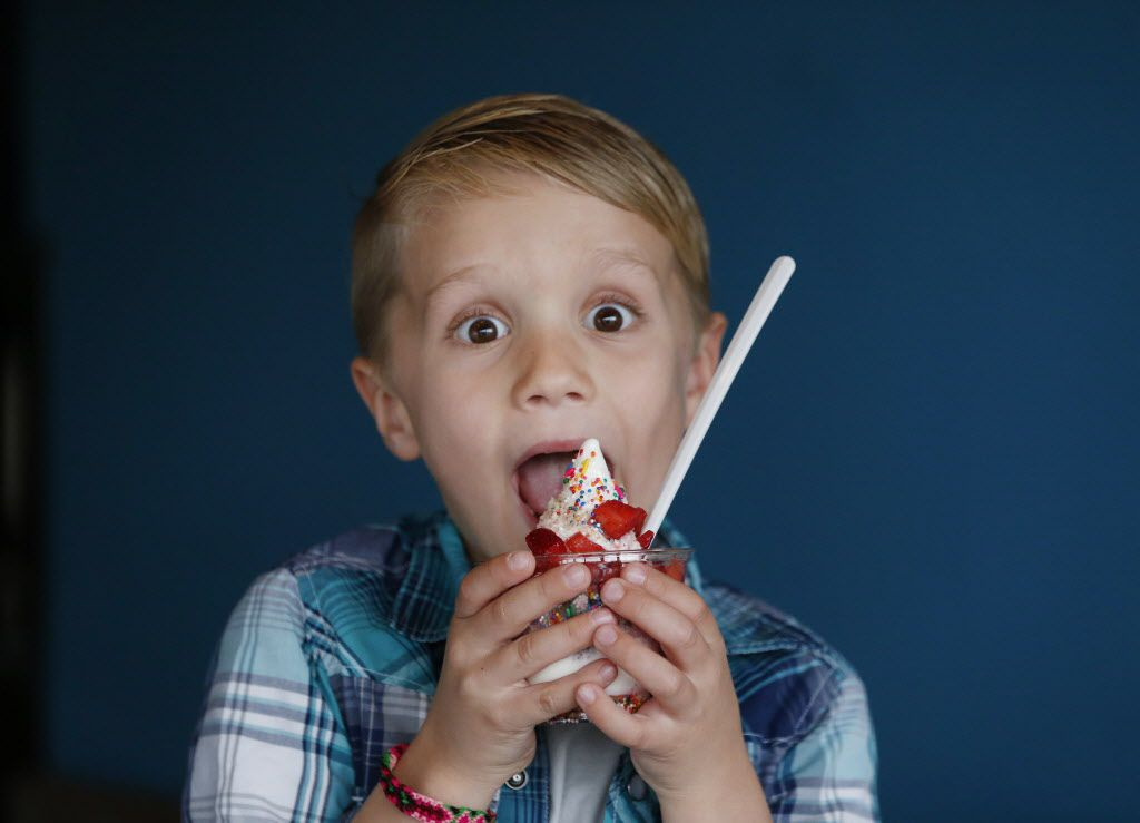 Henry McKibben, 6, of Dallas, eats ice cream while sitting for a portrait for The Dallas Morning News inside the Cow Tipping Creamery store located off Peavy Road in Dallas Thursday March 17, 2016. Cow Tipping Creamery started as food truck in Austin in 2012. The Dallas location, which has not yet opened, is the first storefront for the brand. The company is family-owned by Corey and Timothy Sorensen of Austin, and their son, Cole, 21, works out of the food truck. The store is located inside the Good 2 Go Taco shop. (Andy Jacobsohn/The Dallas Morning News)