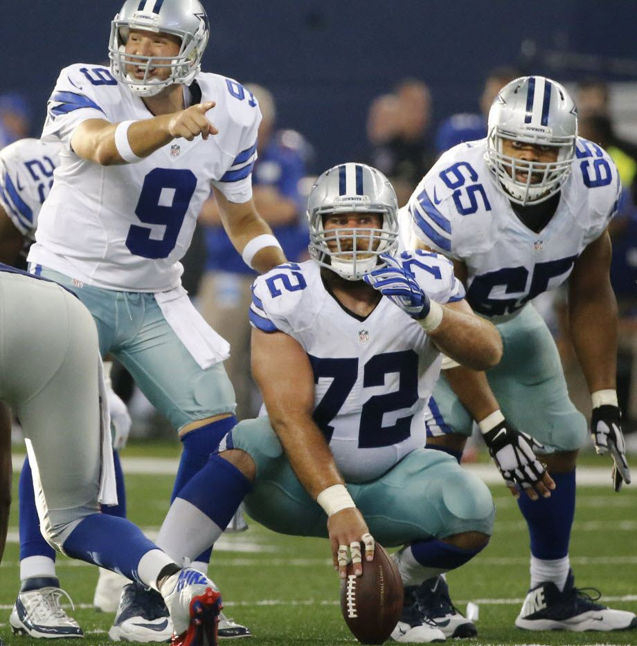 Dallas Cowboys quarterback Tony Romo is pictured with linemen Travis Frederick (72) and Ronald LeaRy (65) during the New York Giants vs. the Dallas Cowboys NFL football game at AT&T Stadium in Arlington on Sunday, October 19, 2014.  (Louis DeLuca/The Dallas Morning News) 10242014xBRIEFING