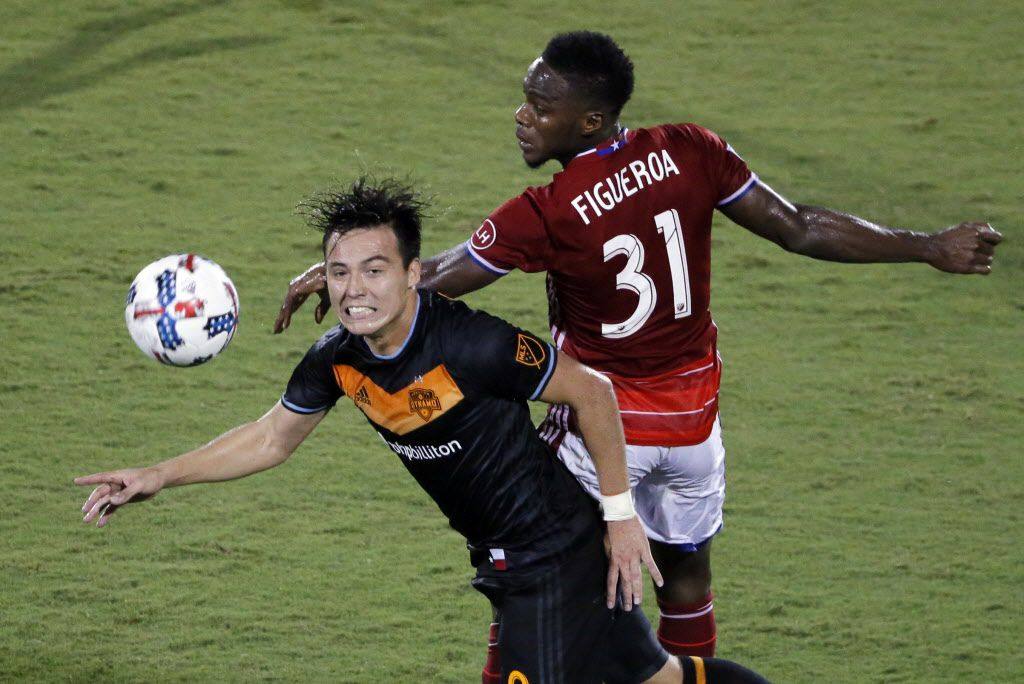 Houston Dynamo forward Erick Torres (9) and FC Dallas defender Maynor Figueroa (31) compete for a loose ball during the second half of an MLS soccer match, Wednesday, Aug. 23, 2017, in Frisco, Texas. (AP Photo/Tony Gutierrez)