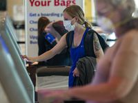Mary McKenna of Dallas uses a Southwest Airlines kiosk at Dallas Love Field airport in Dallas on Sunday, July 26, 2020.