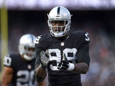 OAKLAND, CA - NOVEMBER 15:  Outside linebacker Aldon Smith #99 of the Oakland Raiders celebrates in the third quarter against the Minnesota Vikings at O.co Coliseum on November 15, 2015 in Oakland, California.