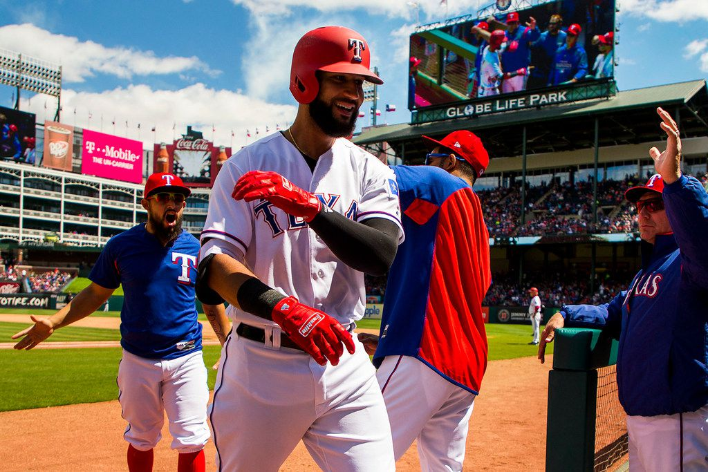 Texas Rangers right fielder Nomar Mazara celebrates on his way back to the dugout after hitting a home run during the fourth inning against the Seattle Mariners at Globe Life Park on Sunday, April 22, 2018, in Arlington.