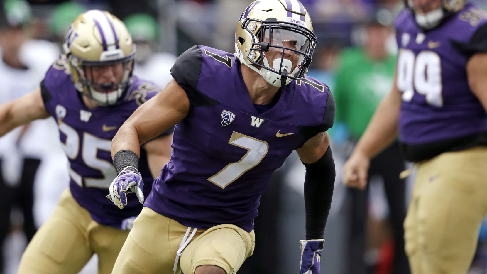 FILE - Washington's Taylor Rapp runs on the field after a play against North Dakota in an NCAA college football game Saturday, Sept. 8, 2018, in Seattle. (AP Photo/Elaine Thompson)