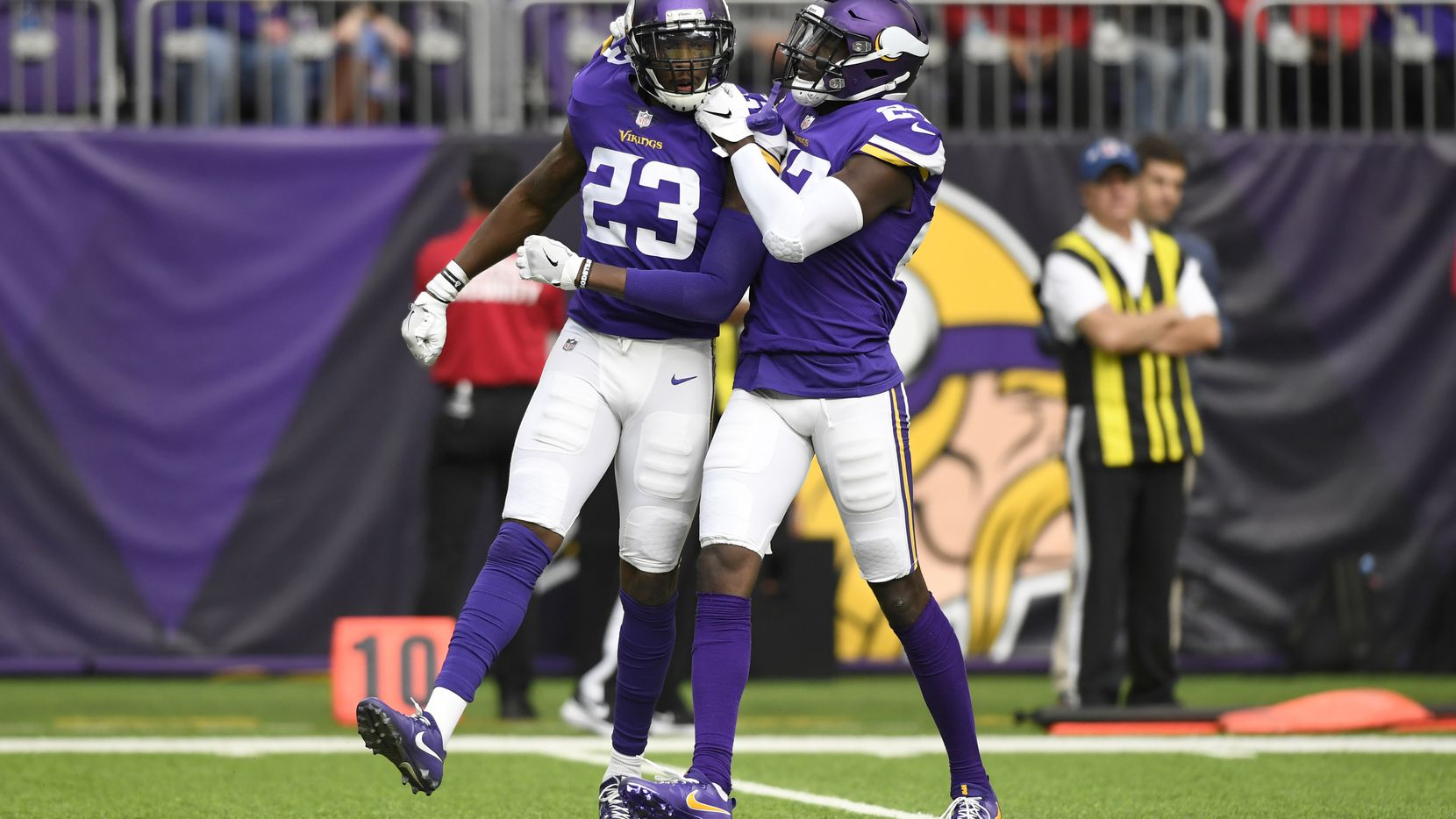 MINNEAPOLIS, MN - OCTOBER 14: George Iloka #23 of the Minnesota Vikings celebrates after tackling Brandon Williams #26 of the Arizona Cardinals in the third quarter of the game at U.S. Bank Stadium on October 14, 2018 in Minneapolis, Minnesota. (Photo by Hannah Foslien/Getty Images)