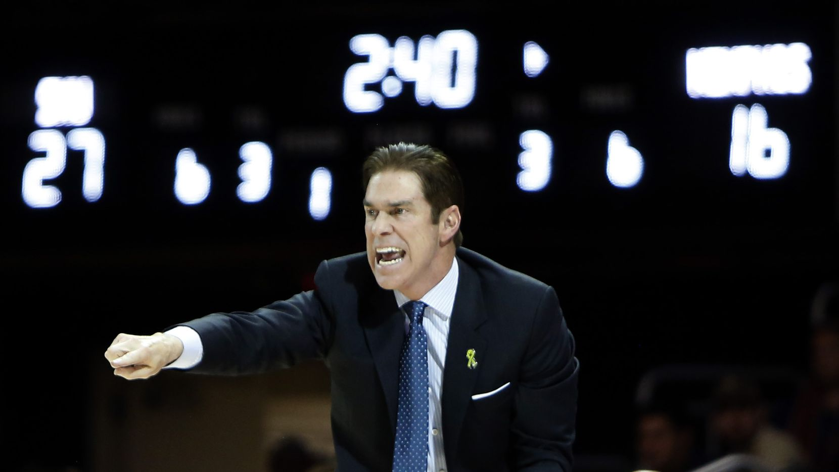 SMU head coach Tim Jankovich emphatically sends game strategy into his players during first half action against Memphis. The two teams from the NCAA's American Athletic Conference played their men's basketball game at SMU's Moody Coliseum in Dallas on February 25, 2020.