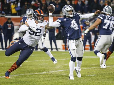 Dallas Cowboys quarterback Dak Prescott (4) fires off a pass before being brought down by Chicago Bears defensive end Brent Urban (92) during the second half a NFL matchup between the Dallas Cowboys and the Chicago Bears on Thursday, Dec. 5, 2019, at Soldier Field in Chicago.