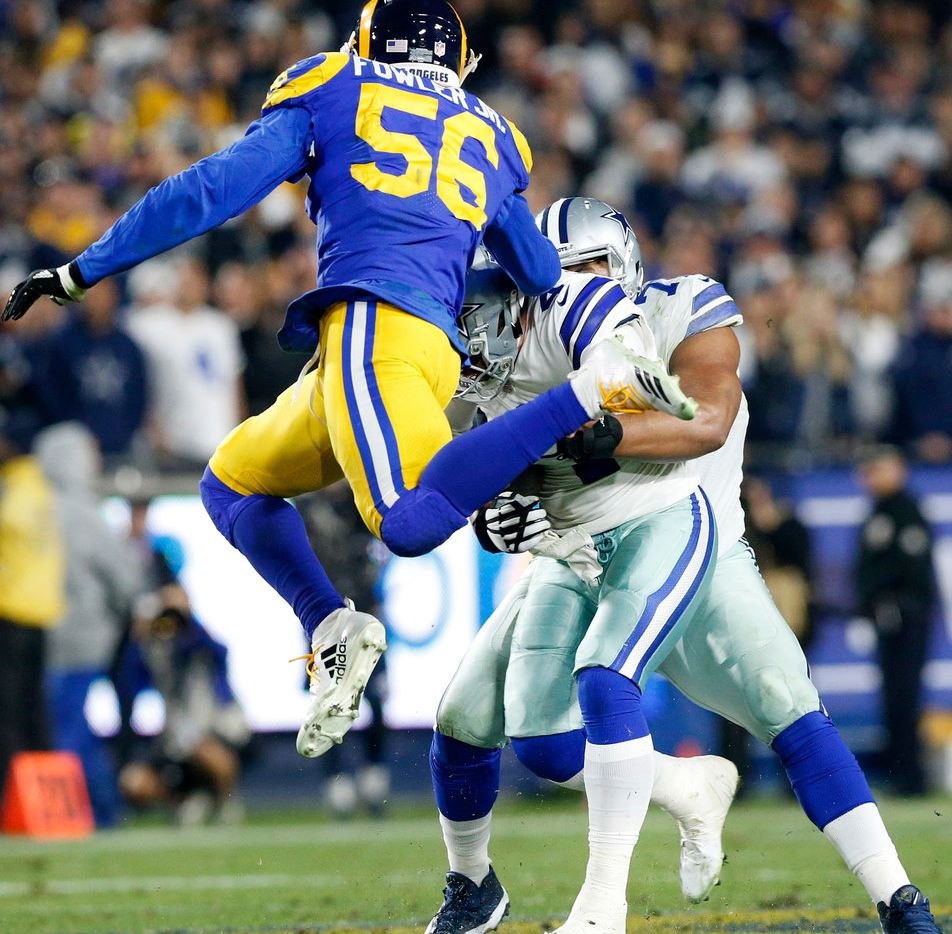 Dallas Cowboys offensive tackle La'el Collins (71) tries to protect quarterback Dak Prescott (4) from being sacked late in the second quarter by Los Angeles Rams linebacker Dante Fowler (56) in their NFC Divisional Playoff game at Los Angeles Memorial Coliseum in Los Angeles, Saturday, January 12, 2019. (Tom Fox/The Dallas Morning News)