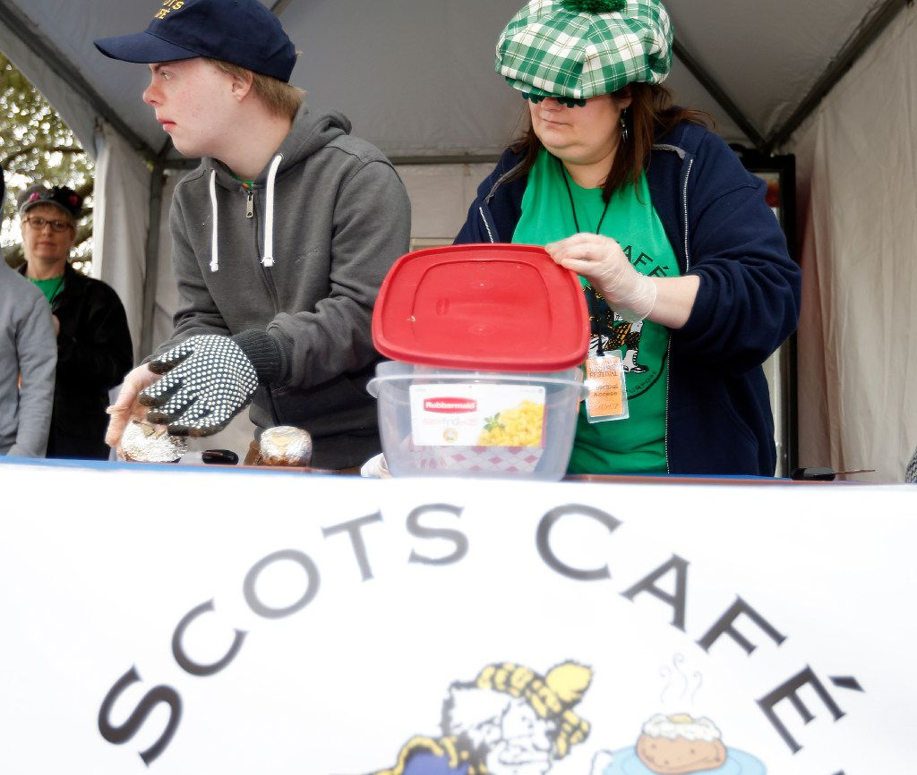 Scots Café student Luke Andrews, left, and Kerry Fergason prepare a baked potato for a customer during the North Texas Irish Festival on March 4 at Fair Park.