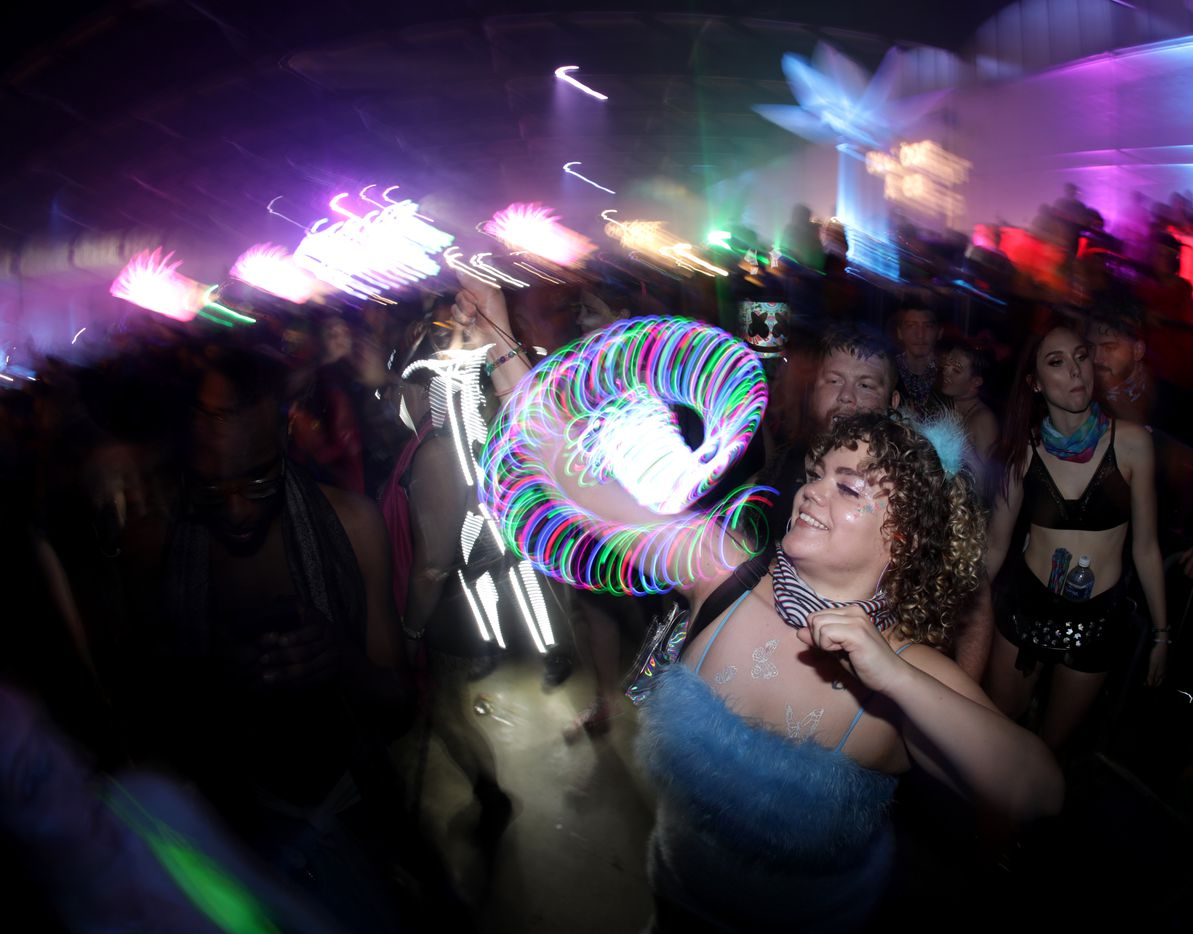 Guests dance to the music during Lights All Night at Dallas Market Hall in Dallas, Texas, on Dec. 27, 2019.
