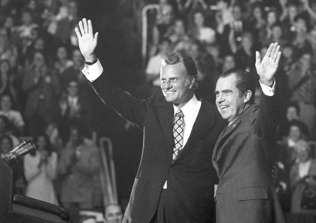 On Oct. 16, 1971, evangelist Billy Graham and President Richard Nixon waved to a crowd of 12,500 at ceremonies honoring Graham at Charlotte, N.C.