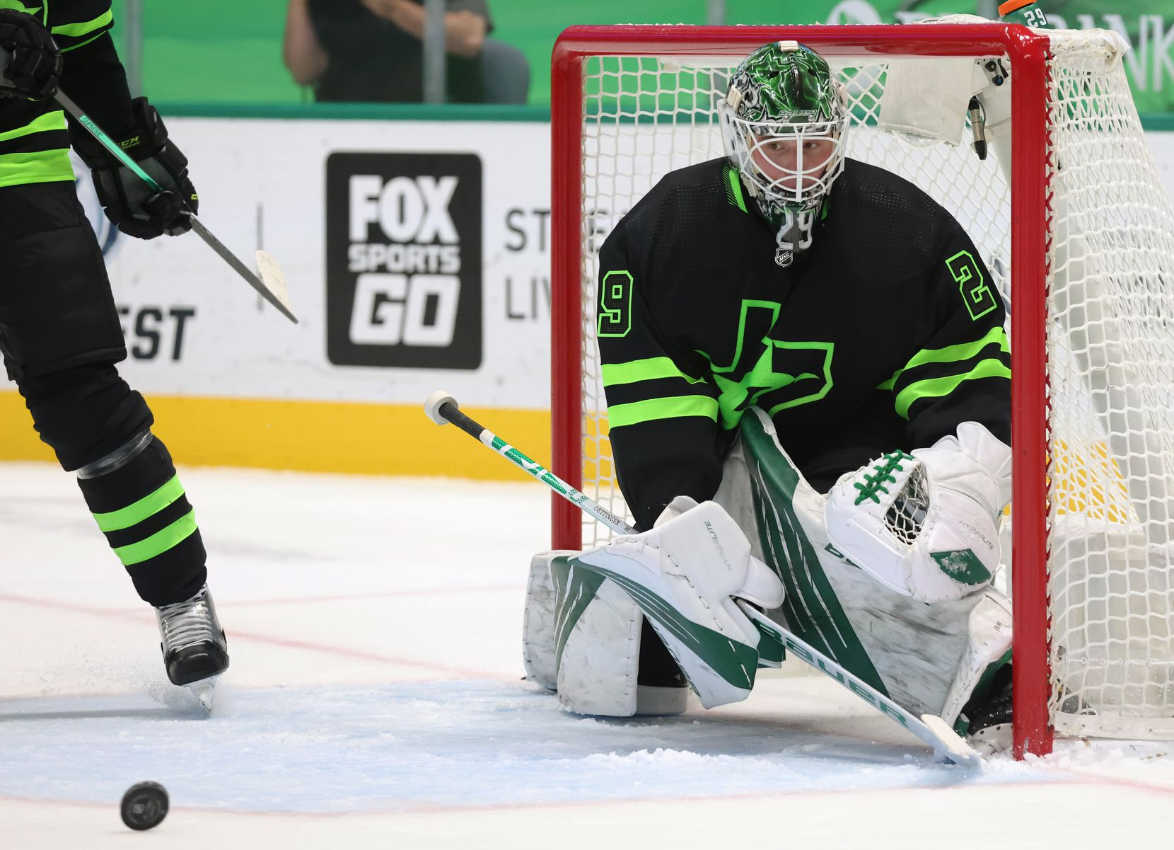 Dallas Stars goaltender Jake Oettinger (29) watches as the puck rolls in a game against the Detroit Red Wings during the second period of play at American Airlines Center on Thursday, January 28, 2021in Dallas. (Vernon Bryant/The Dallas Morning News)