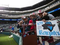 Dallas Renegades fans cheer as the team warms up before an XFL game between the Dallas Renegades and the New York Guardians on Saturday, March 7, 2020 at Globe Life Park in Arlington.